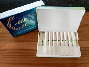 An opened box of Original Cigoo Sticks