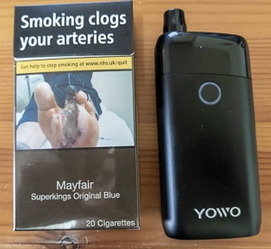 UWOO YOWO device pictured next to a packet of cigarettes